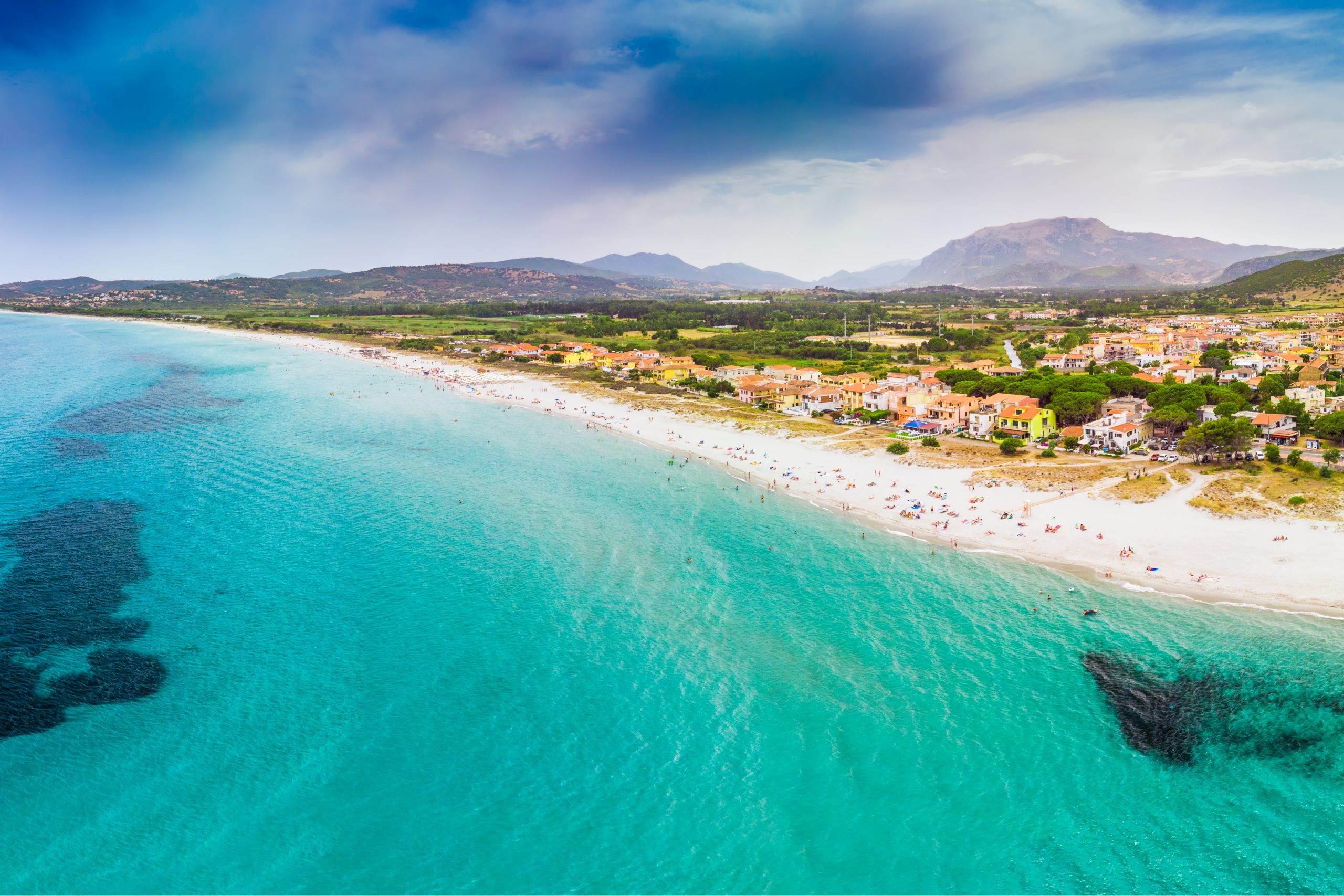 Graniro beach and La Caletta town, Sardinia, Italy, Europe.